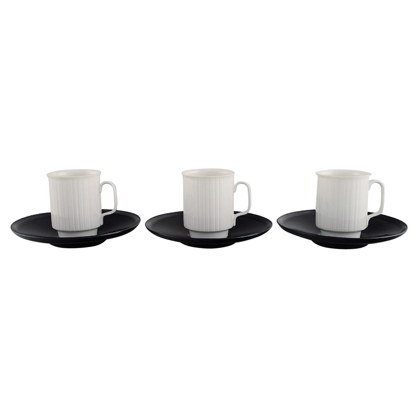 Tapio Wirkkala for Rosenthal, Three Porcelain Noire Mocha Cups with Saucers