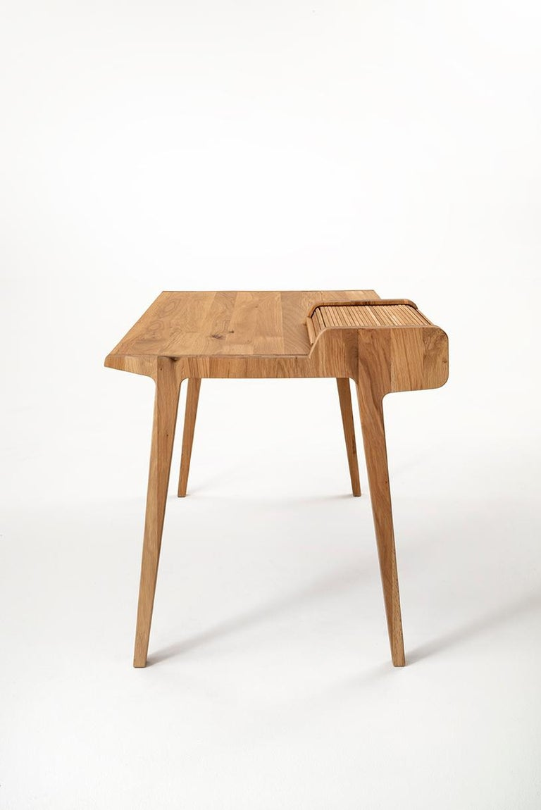 Tapparelle is a desk in solid oak with a strong and material grain, where the sinuous and modern forms are the counterpart of a solid structure enhanced by the material and by the very high quality of the workmanship, largely artisanal. The desk is