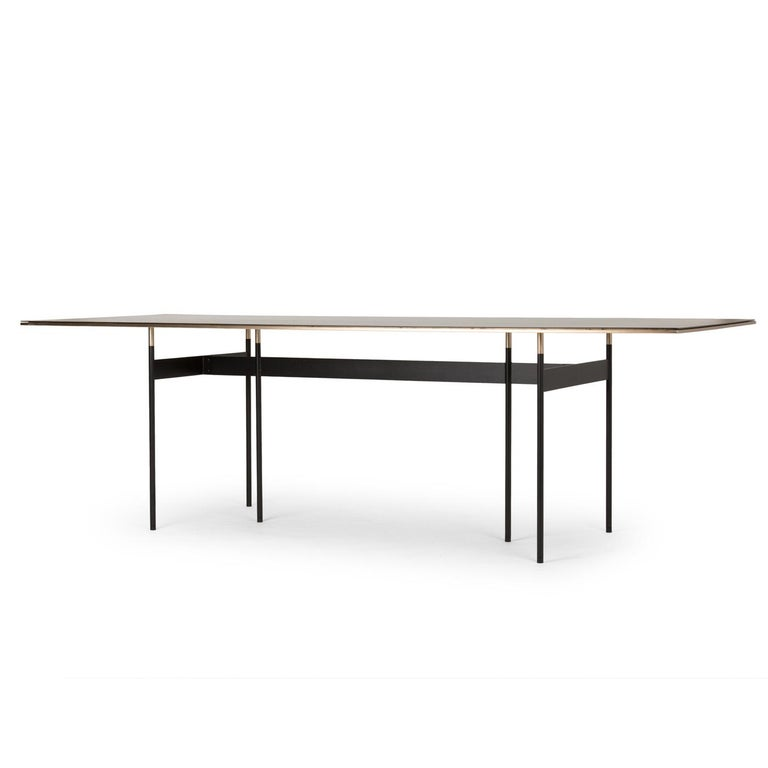 Designed by Simone Bonanni, this exquisite table mixes the horizontal lines of the top, with the vertical elements of the inner structure and legs, creating a piece made of air and metal. Visually rigorous, elegant, and exclusive, its silhouette