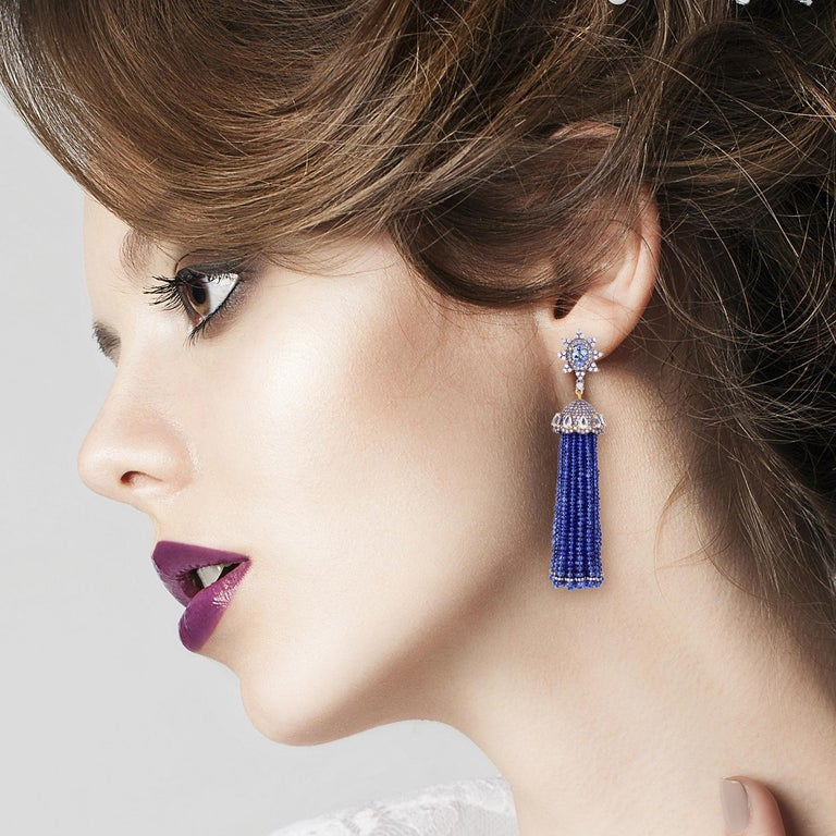 These stunning exceptional tassel earrings are handmade in 18-karat gold and sterling silver.  It is set with 157.8 carats sapphire, 2.0 carats tanzanite and 4.835 carats of glittering diamonds.   Please note that carat weights may slightly vary as