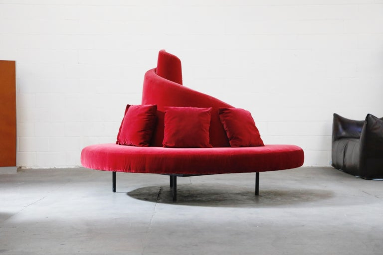 This wild and amazing Postmodern 'Tatlin' center sofa was designed by Mario Cananzi and Roberto Semprini and produced by Edra in 2002. Covered in a sumptuous red velvet fabric over a steel and wood frame, this high quality and substantially sized