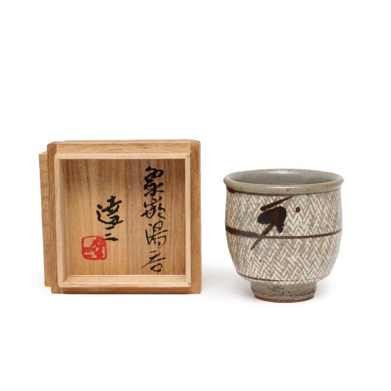 "Tatsuzo Shimaoka  Yunomi with Signed Box  underglaze iron decoration 3.25 x 3 x 3"" date unknown signed by artist"
