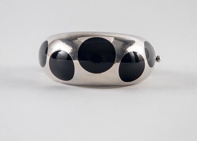 Taxco Sterling Silver and Black Bakelite Polka Dot Bracelet Interior diameter: 2.25
