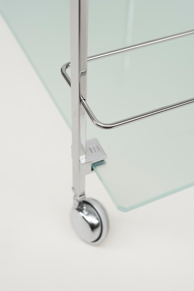 The table frame is made of tubes and casted parts which clamp the glass. The tempered glass has a thickness of 10 mm and is held by casted parts. The table is strong and can bear a lot of weight. The table can be shipped flat packed. Sand casting is