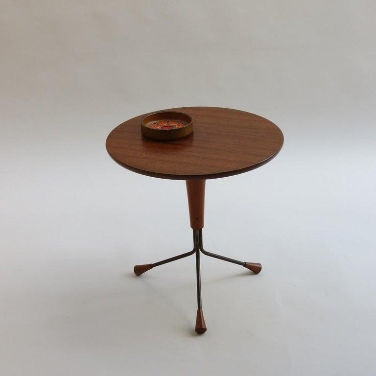 Wonderful 3 legged teak side table designed by Albert Larsson for Alberts Tribro, Sweden. Teak top and brass legs with very nice teak detail to the foot. Originally designed in 1959, this is a 1960s edition. In good vintage