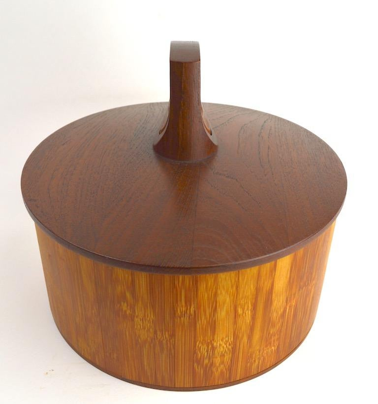 Rare model 1510 teak and cane ice bucket designed by Jens Quistgaard for Dansk. This example is in very good, original condition, clean and ready to use, or just display. Sophisticated architectural form, with early Dansk Ducks mark. A hard to find