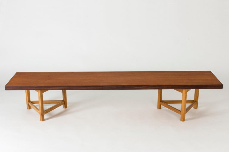Teak bench with loose oak tripod legs by Finnish interior architect Gustaf Hiort af Ornäs. Works well as a sideboard or room divider. Clean, simplistic lines and great quality.