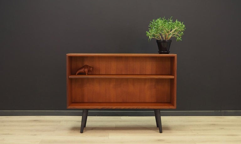 Classic bookcase / library from the 1960s-1970s, Scandinavian minimalism. The surface of the furniture finished with teak veneer. Shelf with adjustable height. Maintained in good condition (minor bruises and scratches), directly for
