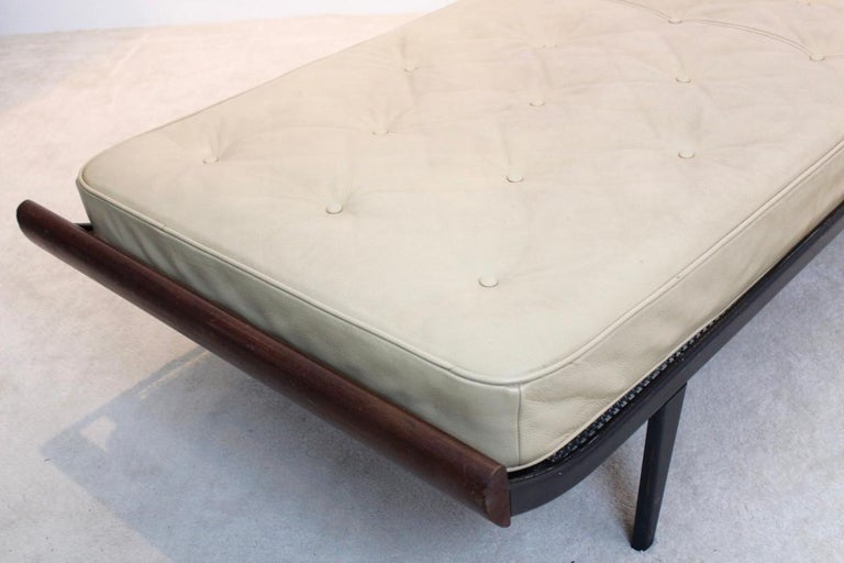 Stunning cleopatra daybed in teak and with steel base. Designed by Dick Cordemeijer for Auping in the 1950s. Teak wood ends with enameled black metal frame. Frame in original condition with signs of normal use. This daybed comes with the original