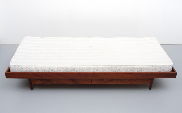 Teak daybed. Nice and simple design. Underneath two drawers. Solid teak, 1950s, Holland. Good condition. Mattress included.