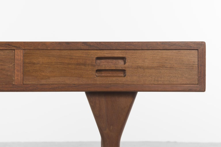 A very elegant desk by Danish designer Nanna Ditzel, 1958. Fine lines and robust structure in teak, 3 deep drawers maintained by 4 feet, Each drawer is almost the full depth of the desk top and all are made using dove-tail joins.  Each drawer has