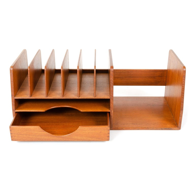 A bench-made solid teak desk organizer with dovetail joinery, comprising five correspondence dividers, a slim drawer and open storage.