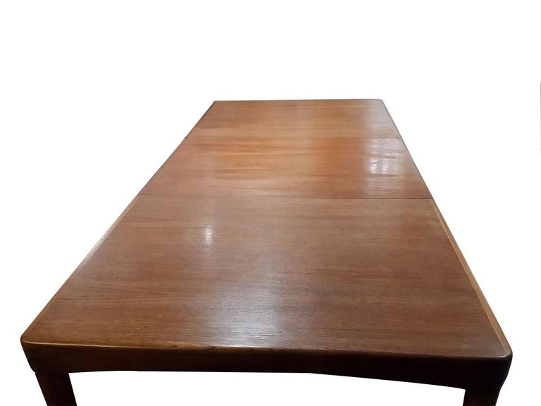 Extending teak dining table by Klein in teak with 1 extension leaf Great natural age  Seats 8 135/195 cm x 90 cm wide  Design by Henry W. Klein for Bramin.