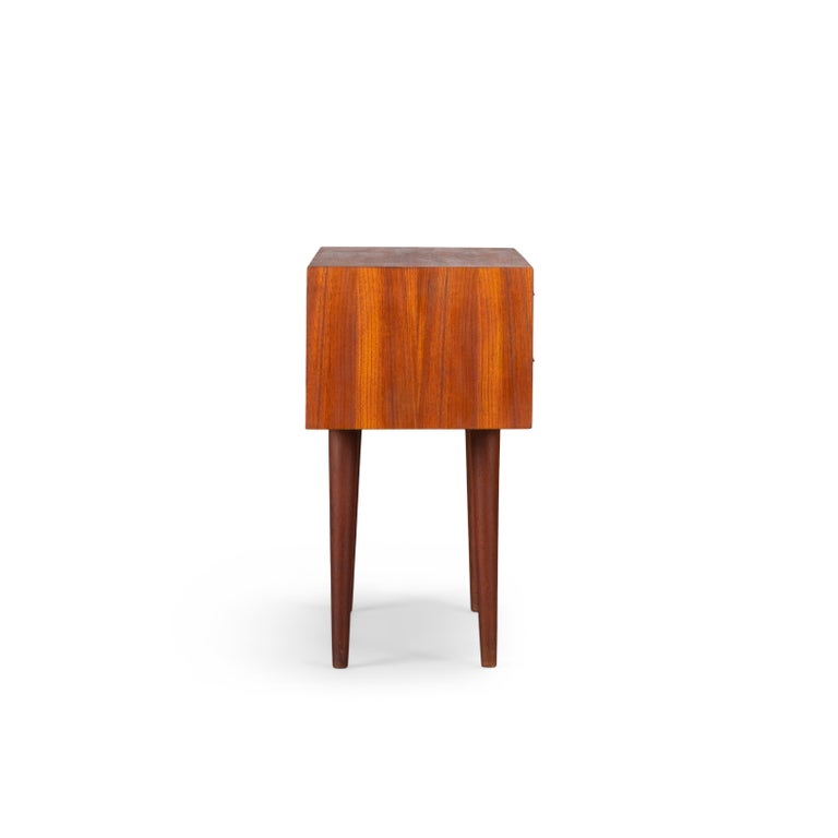 This stylish chest of drawers was designed by Kai Kristiansen and produced by Feldballes Møbelfabrik, Denmark in the 1960s. To be exact 29 March 1962. This cabinet is made of teak and has beautiful detailed lines with his signature eyelid handles,
