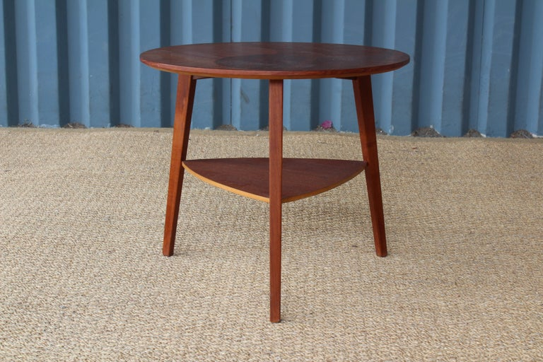 Teak end table with a pattern inlaid veneer surface, made in Denmark in the 1950s.