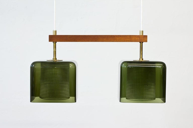 Swedish Teak, Glass and Brass Hanging Lamp by Carl Fagerlund for Orrefors, Sweden, 1960s For Sale