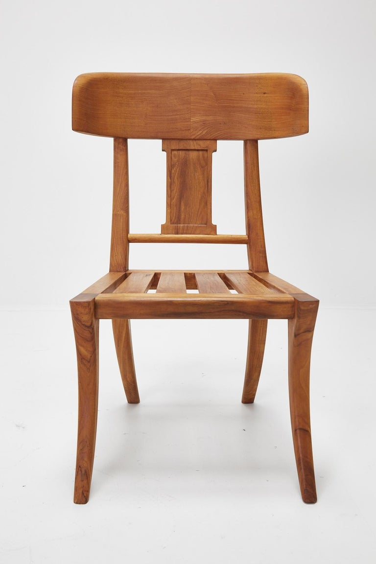 Beautiful solid teak side chair or dining chair with classical Klismos styling. Can be used inside or outside.