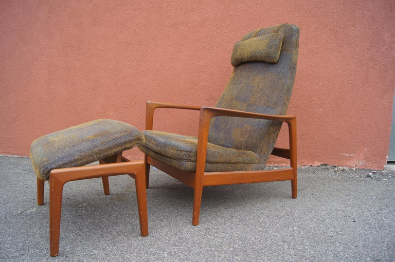 Designed by Folke Ohlsson for DUX, this handsome 1960s lounge chair and ottoman features a teak frame that adjusts while seated to provide a comfortable recline.