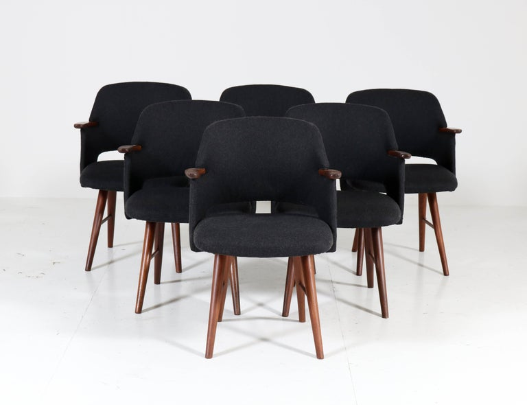 Wonderful and rare set of six Mid-Century Modern FT30 dining chairs. Design by Cees Braakman for UMS Pastoe. Striking Dutch design from the sixties. Solid teak and re-upholstered with stylish Italian black velvet. The chairs are marked with the