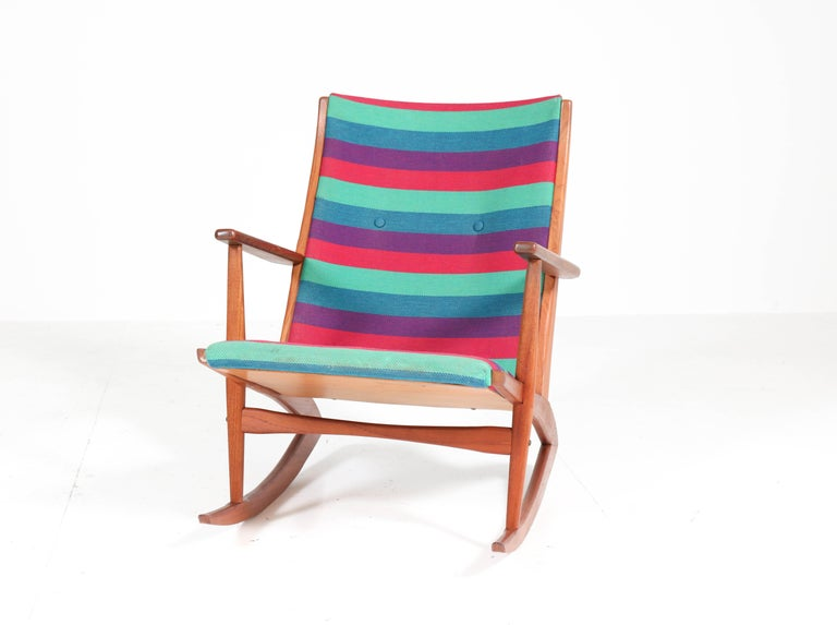 Wonderful Mid-Century Modern rocking chair. Design by Holger George Jensen for Tønder Møbelværk. Striking Danish design from the fifties. Solid teak frame with original upholstery! In very good condition with minor wear consistent with age and