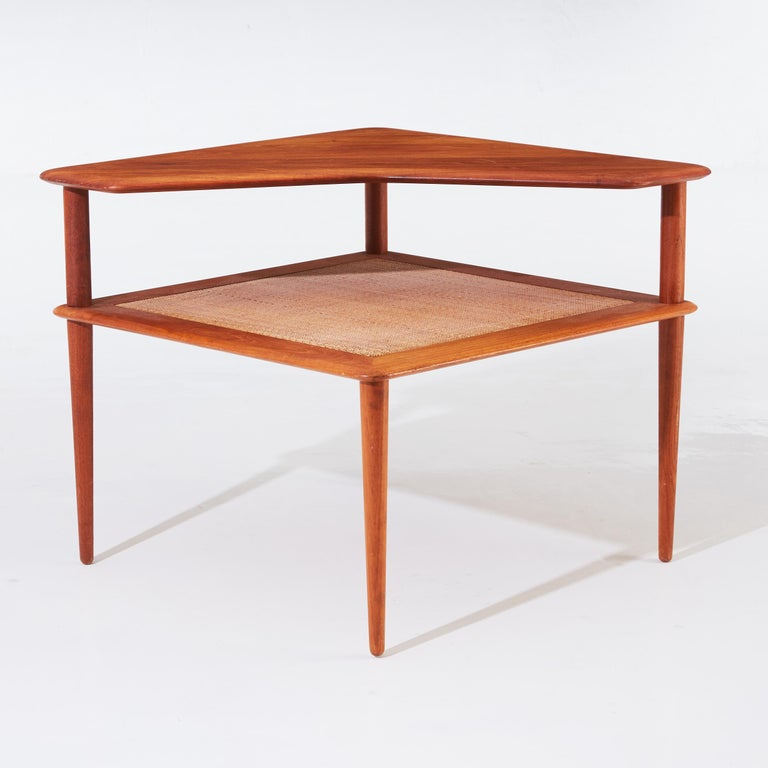 Coffee table by Danish designer duo Peter Hvidt & Orla Molgaard-Nielsen for the Manufacture France & Son in the 1960s. It is made of solid teak, the undertier in weaved bamboo.