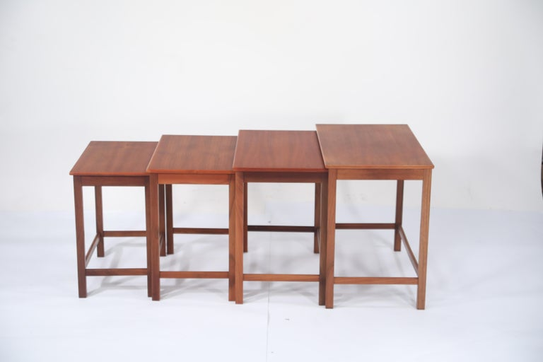 An gorgeous set of four (4) signed teak nesting tables designed by Peter Hvidt and Orla Molgaard Nielsen for Illums Bolighus. This set of nesting tables is in its original beautiful finish, sturdy and structurally sound and ready to be used