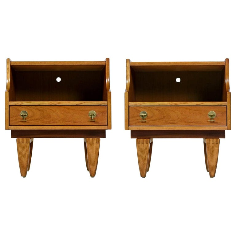 This elegant set of Mid-Century Modern teak nightstands were created by The Stanley Furniture Company in the 1960s. The straight line construction and unique brass drawer pulls add to the appeal. We preserved their patina during the otherwise