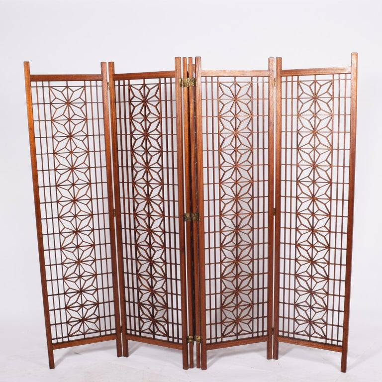 Six-panel screen or room divider made of solid teak with geometric designs.