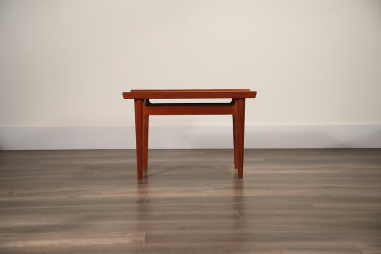 A Classic set of three (3) beautifully grained Teak End Tables, by Finn Juhl for France and Son, Denmark 1960s, and retailed by Illums Bollighus. Priced individually. *NOTE* One has sold, so we now have 2 available.    The rectangular tray top ends