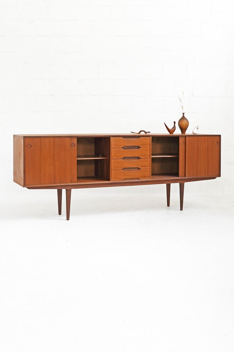 Beautiful teak sideboard by Fredrik Kayser, featuring gorgeous rich teak grain on top, front and side surfaces, with subtle and fine detailing throughout. A great piece in overall good vintage condition.