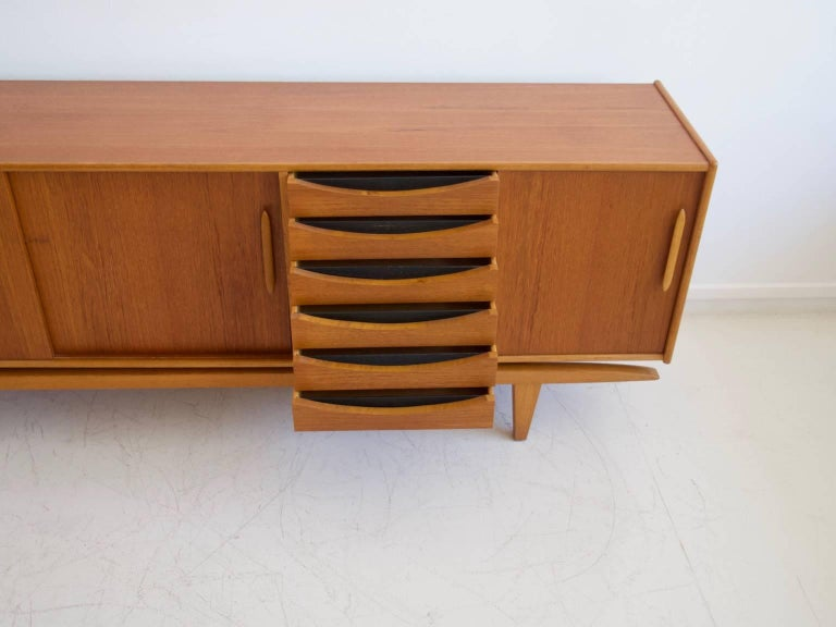 Scandinavian Modern Teak Sideboard with Sliding Doors and Drawers For Sale