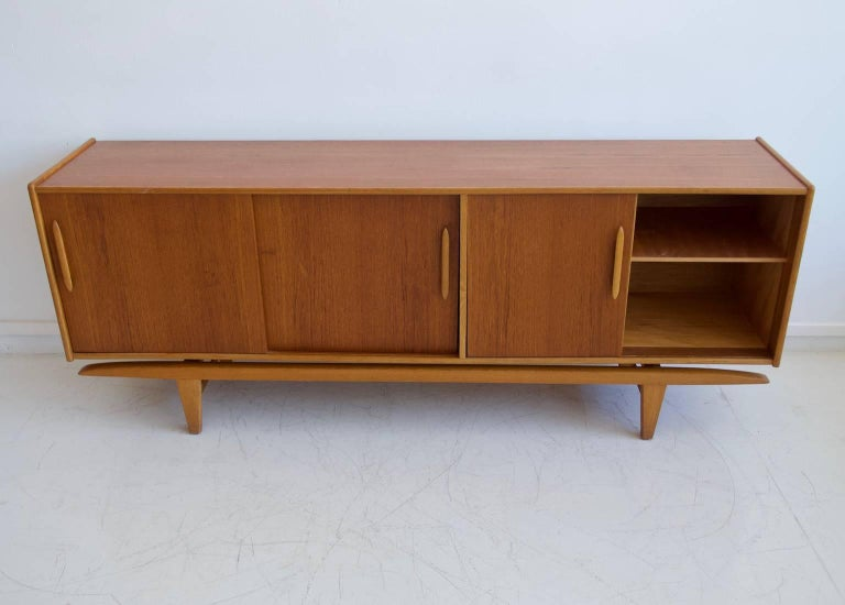 20th Century Teak Sideboard with Sliding Doors and Drawers For Sale