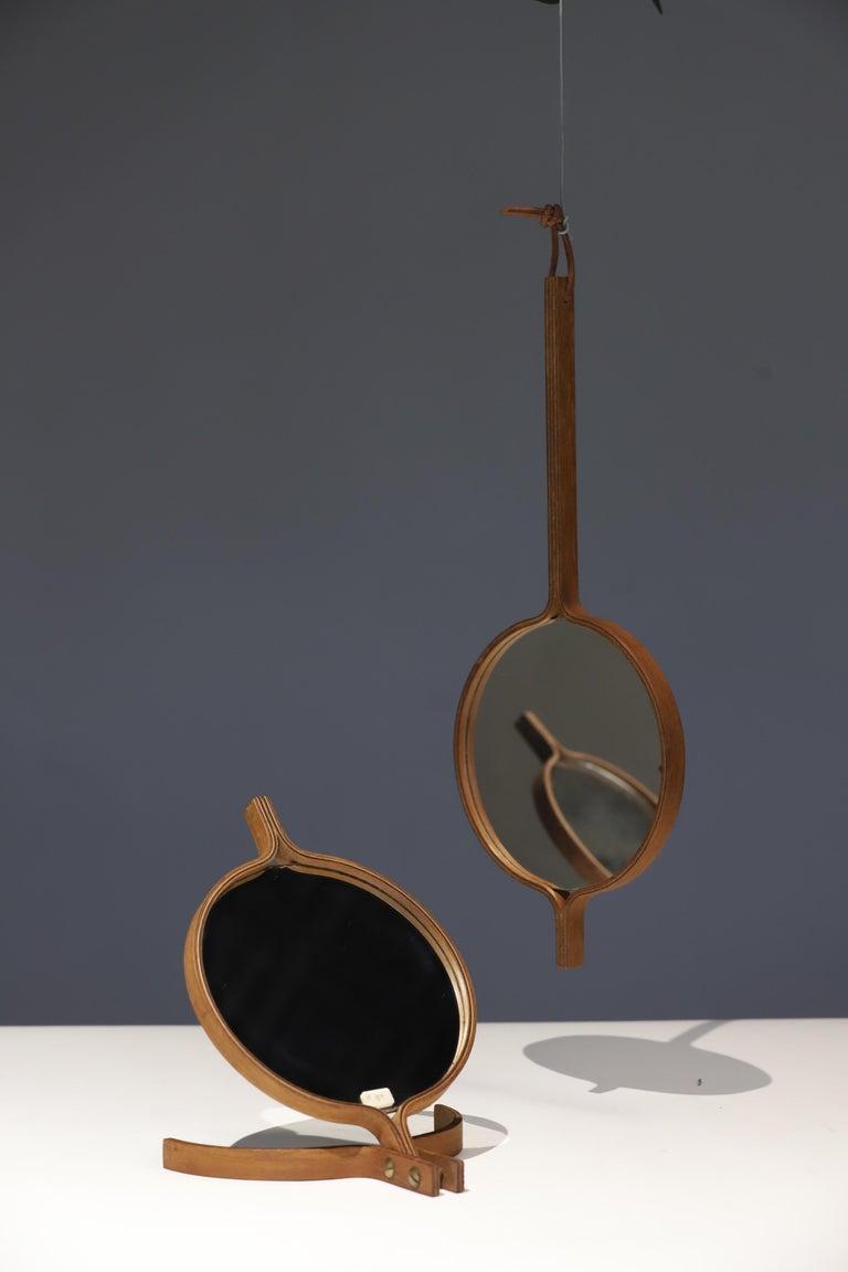 Stunning double sided teak mirrors by Jorgen Gammelgaard, Denmark.