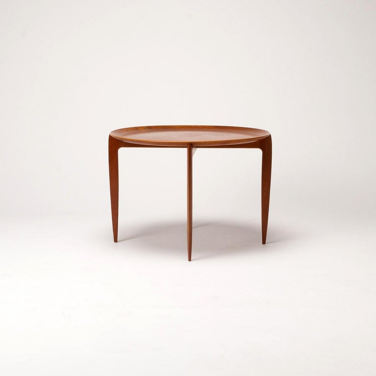 A folding teak tray table designed by H Engholm and Svend Åge Willumsen for Fritz Hansen, Denmark, made in 1966. Great patina and condition.