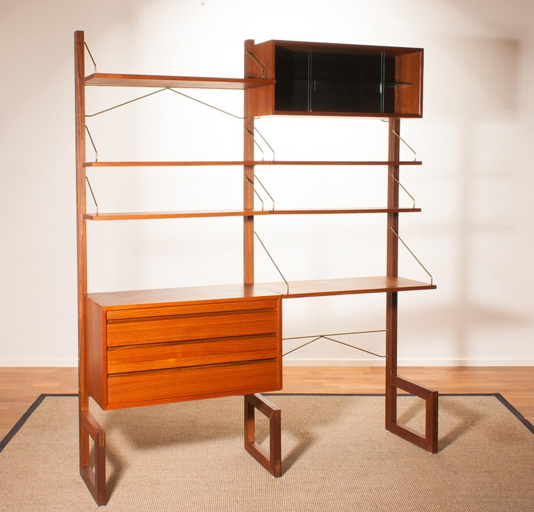 A beautiful and rare freestanding wall unit designed by Poul Cadovius for Cado, Denmark.
