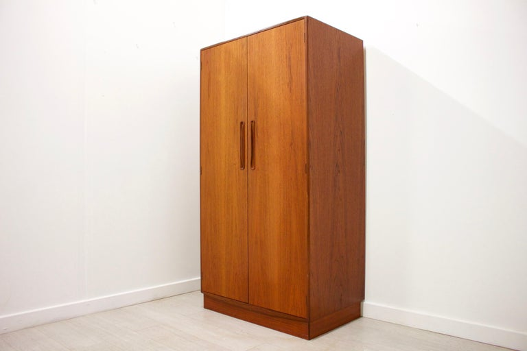 - Mid-Century Modern wardrobe - Manufactured by G Plan - Made from teak and teak veneer - Featuring a hanging rail and shelves.