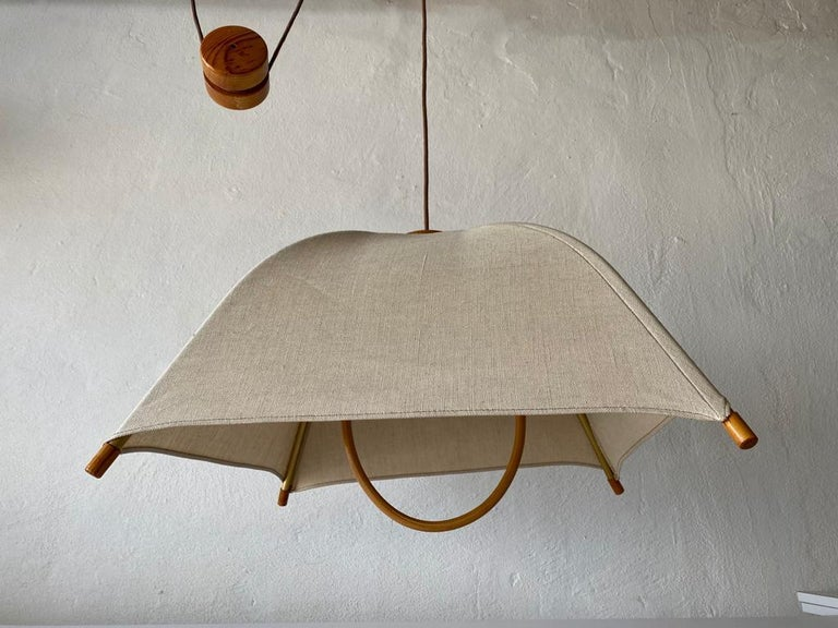 Teak Wood & Fabric Shade Counterweight Pendant Lamp by Domus, 1980s Italy  Minimalist and rare design.   Lampshade is in good condition and clean.  This lamp works with E27 light bulb.  Max 100W Wired and suitable to use with 220V and 110V for
