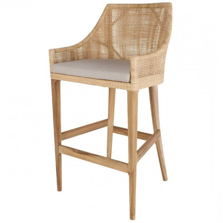 Elegant French design bar stools with teak wooden structure and braided rattan seating shell combining quality, robustness and class. Comfortable and ergonomic, aerial and poetic. The armrests height is 82cm and the seat height is 71cm. In excellent