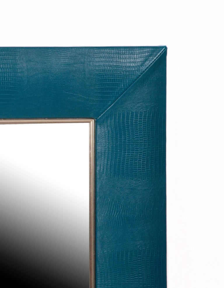 """Lizard embossed Italian leather  1 ¼"""" bevelled mirror 4"""" wide leather frame handstitched corners Measurements including frame: 30"""" W x 36"""" H x 1"""" D  For custom sizes request a quote or call our office to speak to a"""
