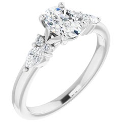 Tear Drop Three-Stone Diamond Accented GIA Certified Oval Cut Engagement Ring
