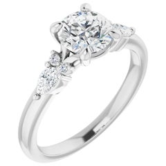 Tear Drop Three-Stone Diamond Accented GIA Certified Round Engagement Ring