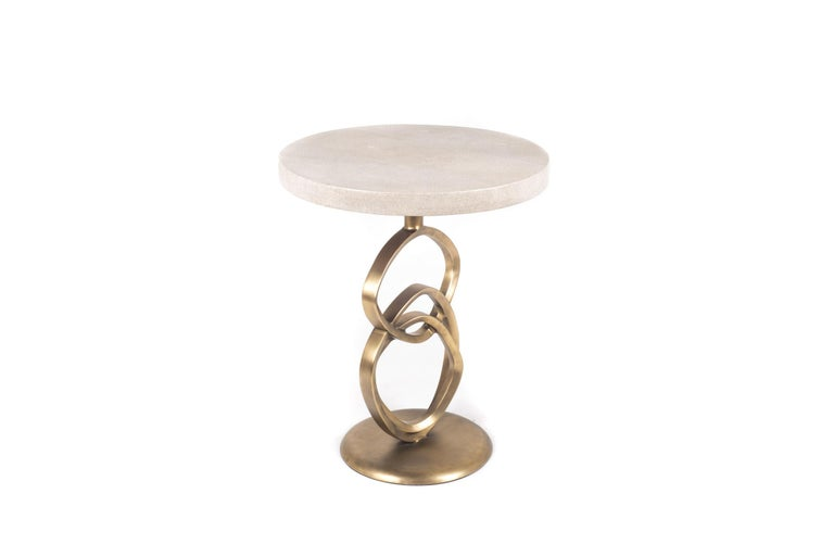 The Teardrop I side table is an elegant design with exquisite detailing. The sculptural rings are inlaid in bronze-patina brass and the top is in cream shagreen. This piece is designed by the daughter of Ria and Yiouri Augousti.   The finish of