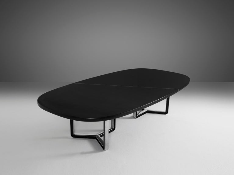 Tecno Design Centre for Tecno,conference table 335a,black lacquered wood, aluminum, Italy, 1975-1978  Large conference table with a black top. The table is composed of two parts that are connected via a metal line. The tabletop rests on two