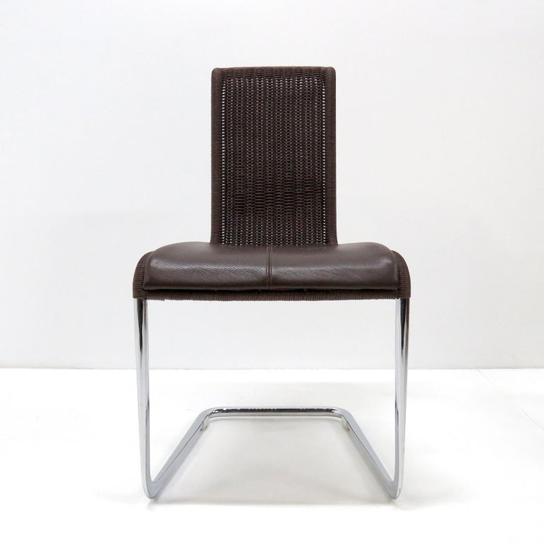 Wonderful high back cantilever chairs B45 by Tecta, 1981 in dark brown wickerwork and detachable brown leather seating pads on a 'tube aplati' chrome plated steel frame. 'Tube aplati' is a steel tube flattening technique that was first used by Jean