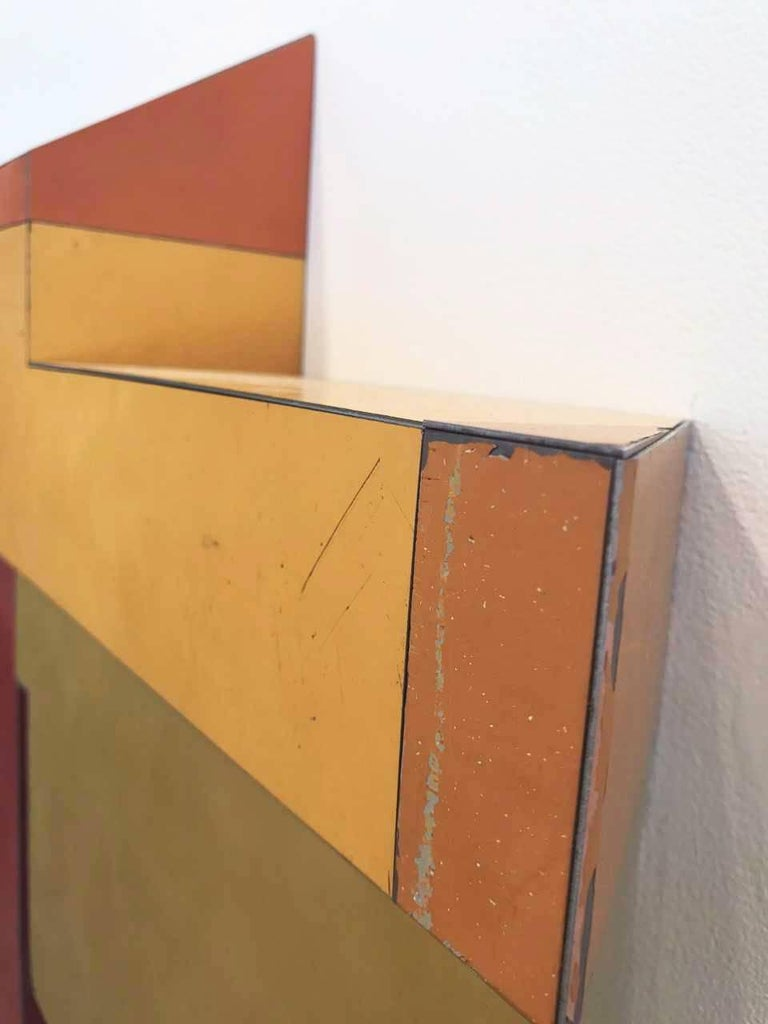 Ted Larsen's Random Logic is a hard-edged sculptural, mixed media painting. The work is primarily red, yellow, and orange in color. It is a graphic, architectural, minimalist three-dimensional painting. Constructivist, Bauhaus, abstract geometric,