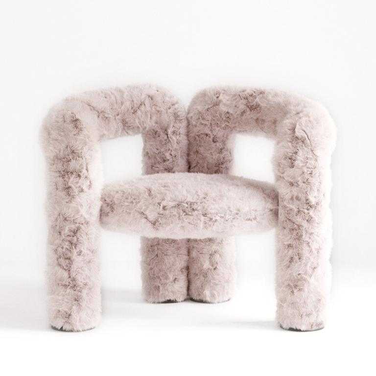 The Teddy chair is our first official seating piece. The upholstered, tubular legs contour up and around the seat cushion, transitioning from leg, to arm, to back support before returning to the floor as legs again. The steel frame's curves are
