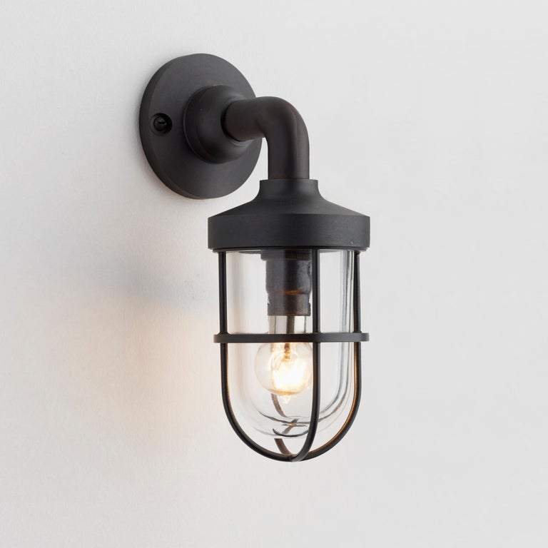 Wall light in brass with clear or frosted glass. For indoor and outdoor use (IP44).  Lamp LED C5 240V B15d 1,4W 2500K 130lm. Main power 230V.