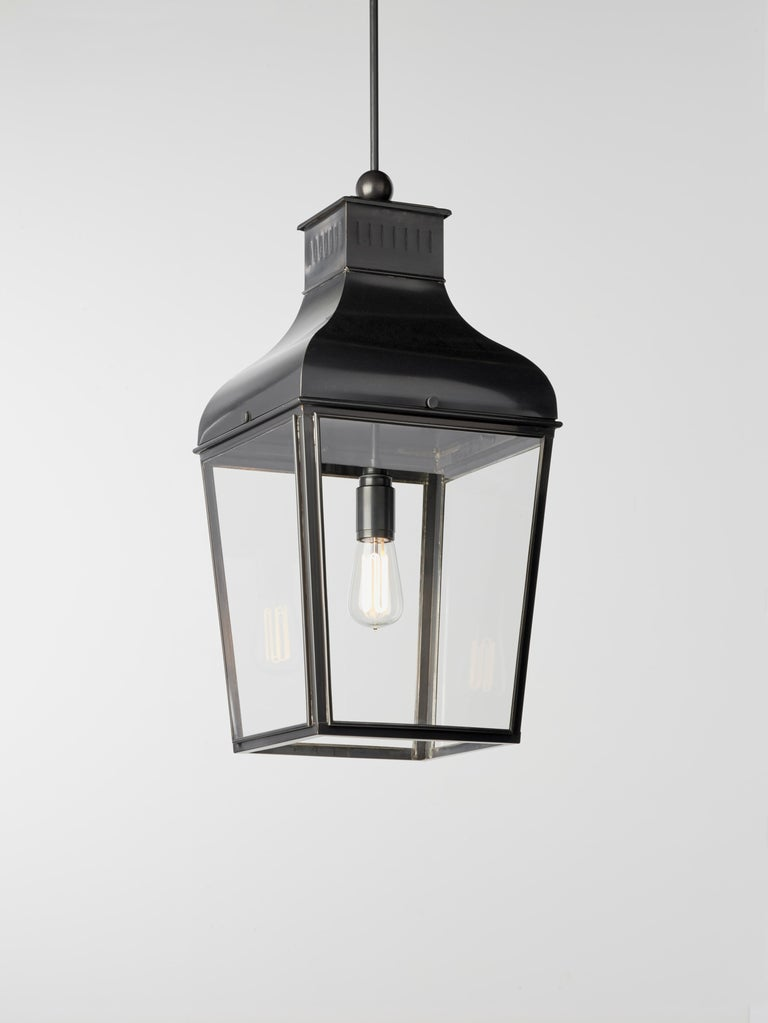 Hanging light in dark bronze with pagoda structure, closed top, outside fitted clear glass. For indoor and outdoor use (IP43). For suspension please inquire regarding additional accessories.   Light source by 'Flatspot 2' downlighter with LED