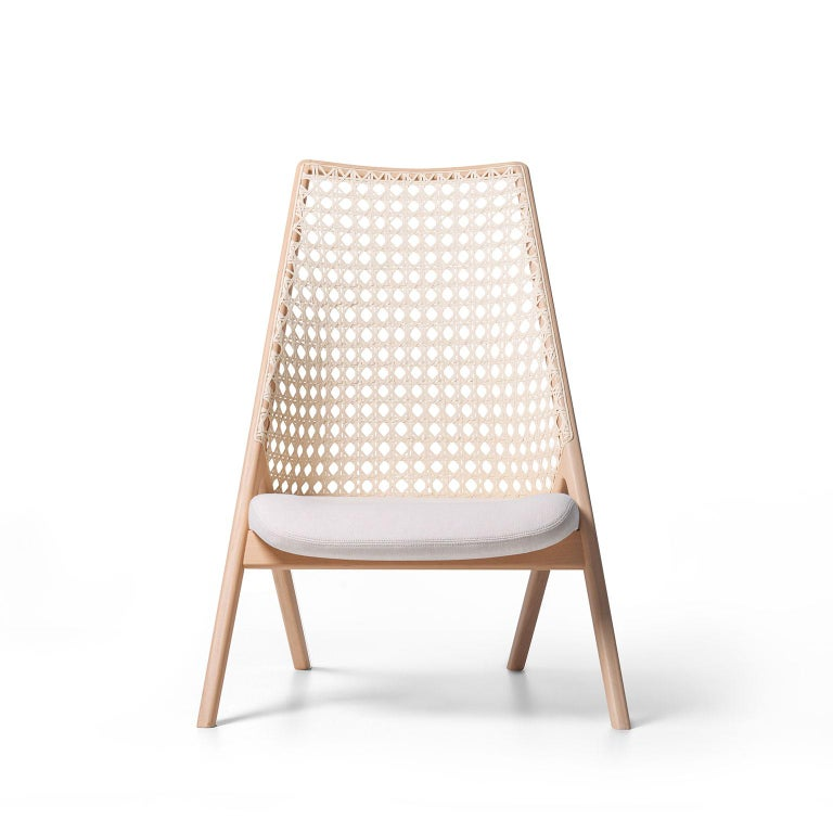 Tela lounge chair is a fusion of contemporary design and traditional Brazilian materials. The backrest weave is inspired by the Classic cane woven pattern of the midcentury furniture. It was recreated in a larger scale and made with cotton thread