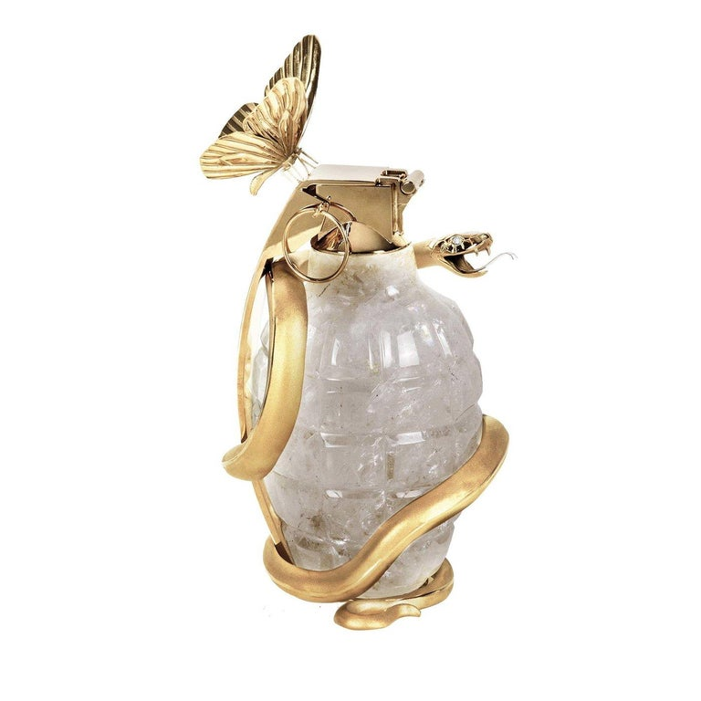 In rock crystal and 24-karat English gold-plated bronze, this piece from the Tempus Fugit collection in a limited edition. By Magnus Gjoen with Baldi, the grenade is adorned with a butterfly and snake in an exploration of the fugacity of time. The